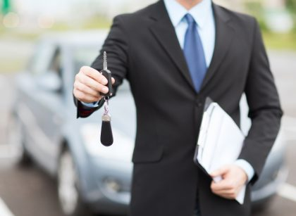 5872779-man-with-car-key-outside